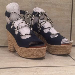Navy blue with white and navy laces
